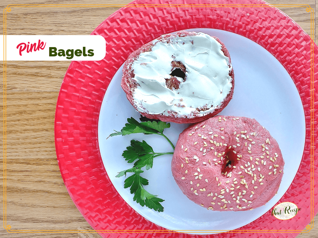 pink bagel on a plate with schmear of cream cheese