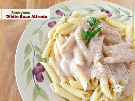 top down view of white sauce on penne noodles with text overlay Faux Fredo White Bean Alfredo""