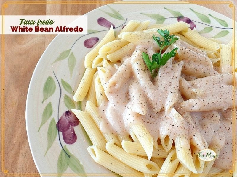 """top down view of white sauce on penne noodles with text overlay Faux Fredo White Bean Alfredo"""""""