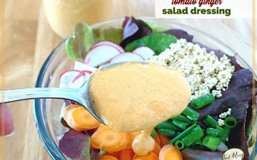 """salad dressing on a spoon over a salad with text overlay """"creamy tomato ginger salad dressing"""""""