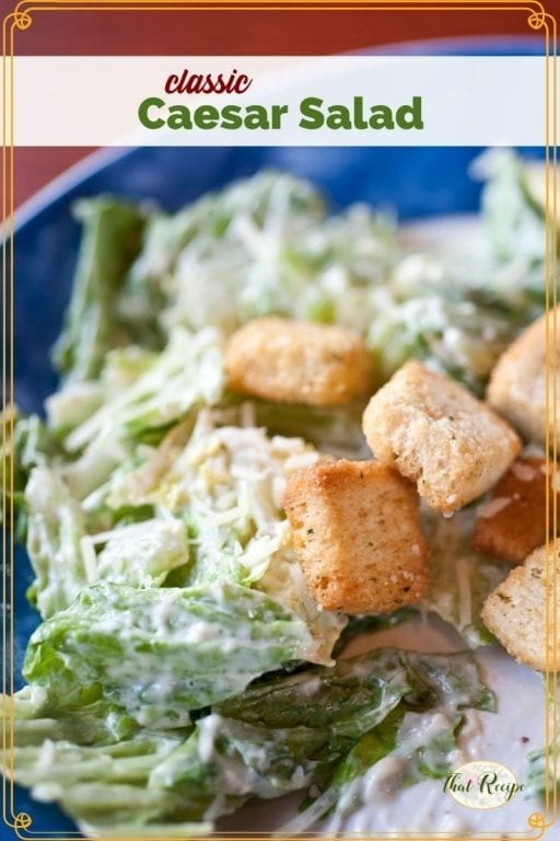 """Close up of salad on a plate with text overlay """"Classic Caesar Salad"""""""