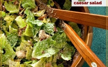 "Top down view of Caesar Salad in a bowl with text overlay ""Classic Caesar Salad"""
