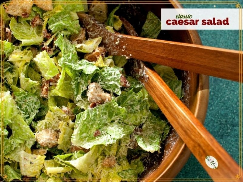 """Top down view of Caesar Salad in a bowl with text overlay """"Classic Caesar Salad"""""""