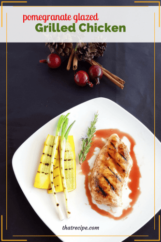 Pomegranate Glazed Chicken on a plate with grilled vegetables.