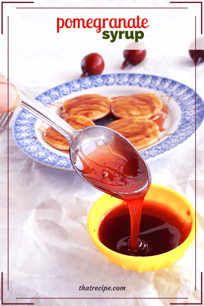 Pomegranate Syrup is a sweet and tangy treat for topping pancakes or use it as a glaze for chicken or pork. #pomegranate #syrup
