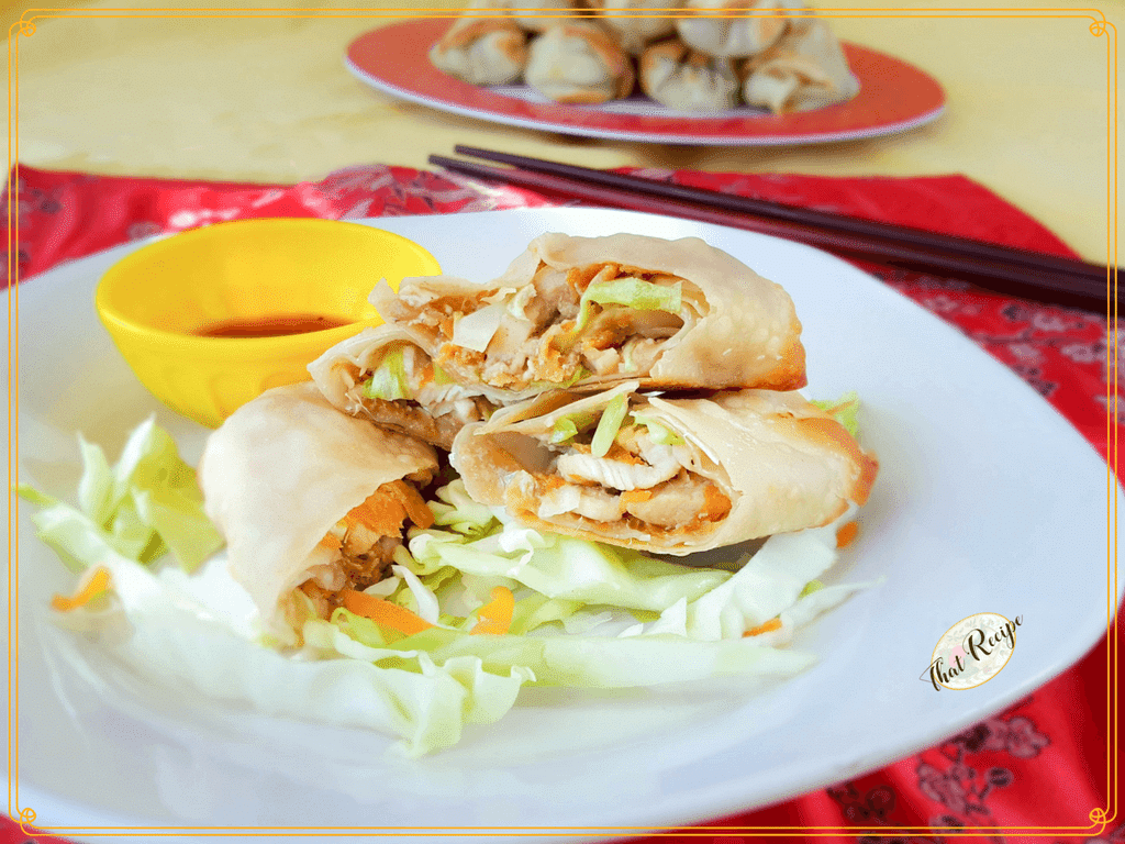 Chicken and vegetable egg rolls on a plate with dipping sauce