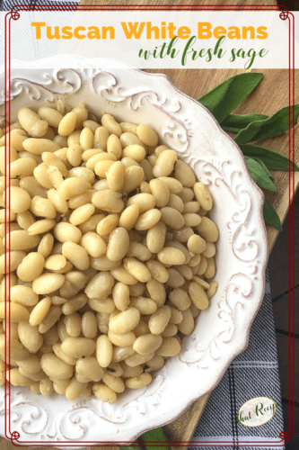 white beans in a bowl with fresh sage