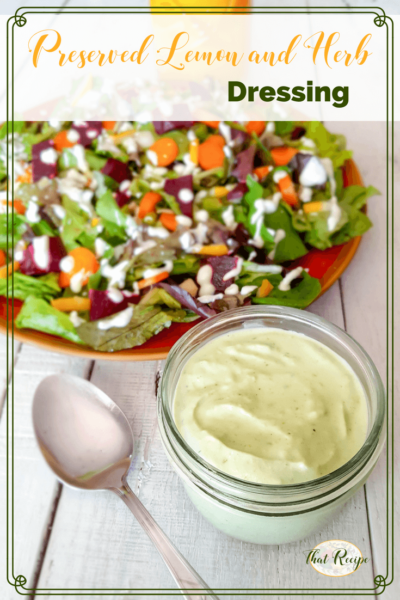 preserved lemon and herb salad dressing in a jar with a plate of salad and a text overlay