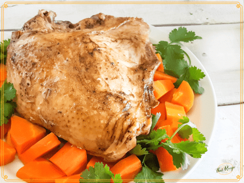 turkey breast on a platter with carrots