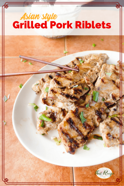 Grilled Asian style pork riblets on a plate with text overlay.