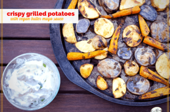 grilled potatoes on a pan with vegan butter mayo sauce