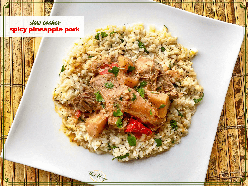 Rice topped with spicy pineapple pork on a square plate