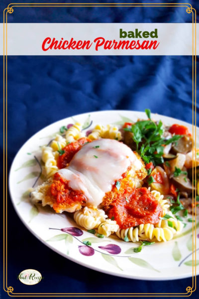 baked chicken parmesan on a plate with pasta and vegetables