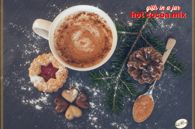 """top down view of mug of hot cocoa with cookies with text overlay """"Gifts in a Jar: Hot Cocoa Mix"""""""