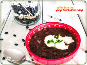 "black bean soup in a jar with text overlay ""gifts in a jar spicy black bean soup"""