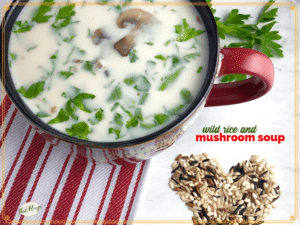"mushroom soup in a mug with text overlay ""wild rice and mushroom soup"""