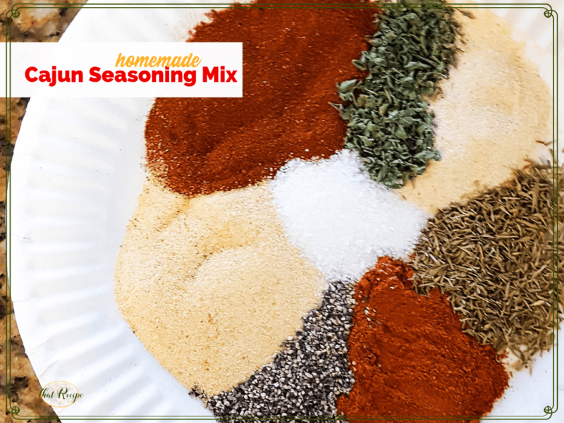 """spices and herbs on a plate with text overlay """"cajun seasoning mix"""""""