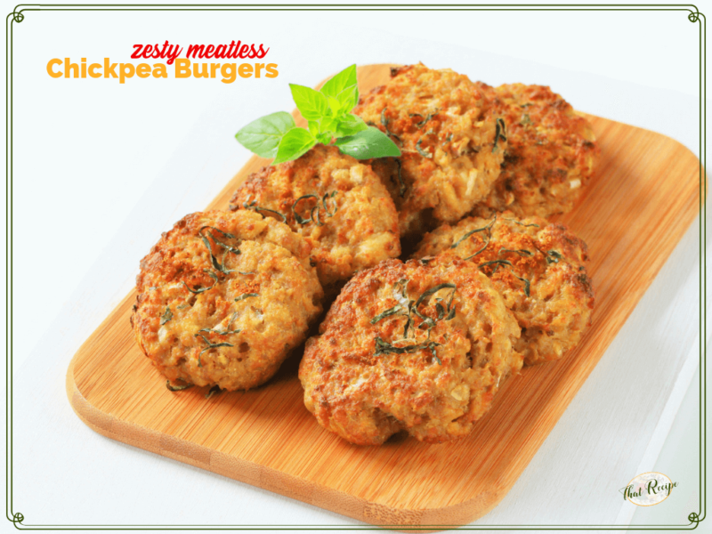 """garbanzo bean burger patties on a wooden board with text overlay """"Zesty meatless chickpea burgers"""""""