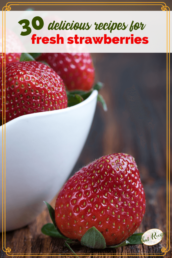 "strawberries in a bowl on a wooden table with text overlay ""30 delicious fresh strawberry recipes"""