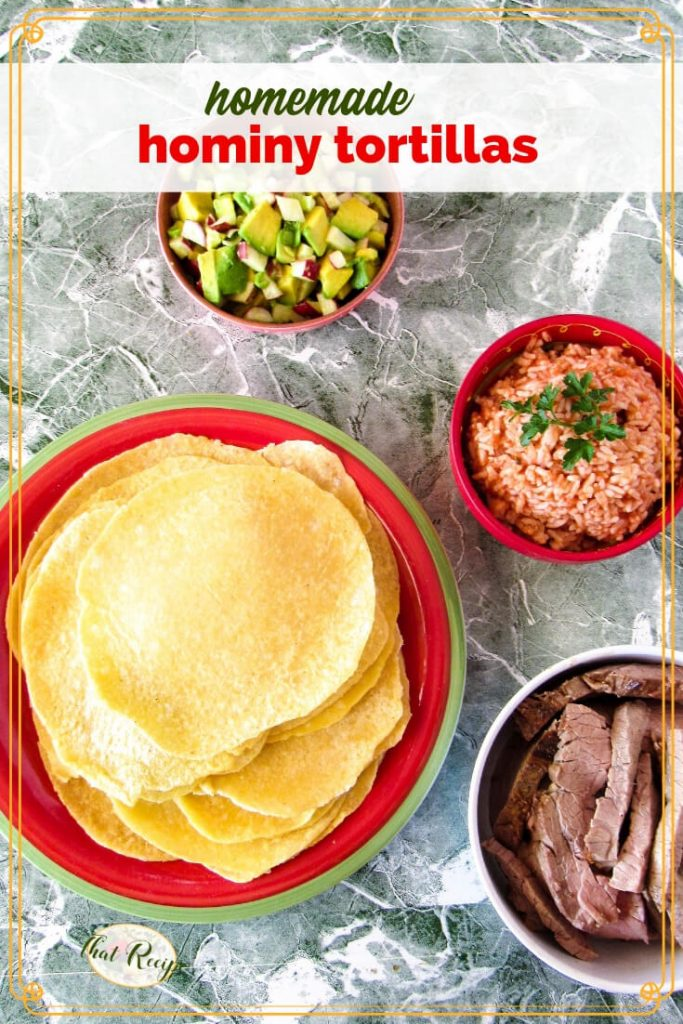plate of hominy tortillas on a table with avocado salsa, Mexican rice and steak strips.