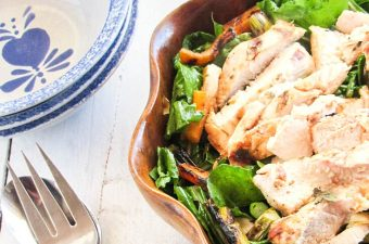 grilled chicken salad in a wooden bowl