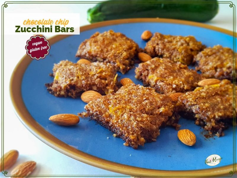 """zucchini bars on a plate with almonds and text overlay """"chocolate chip zucchini bars"""""""