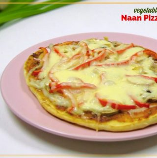 """pizza on a plate with text overlay """"vegetable naan pizza"""""""