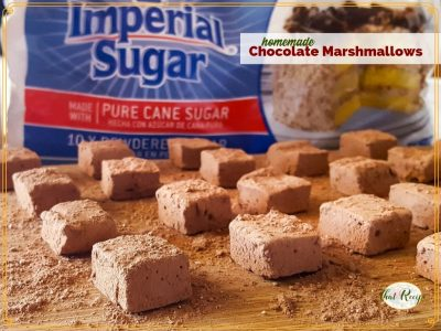chocolate marshmallows on a cutting board with imperial sugar in the background