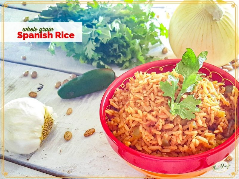 """bowl of spanish rice with text overlay """"Whole Grain Spanish Rice"""""""