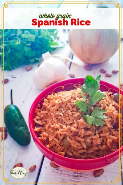 spanish rice in a bowl on the table with onion pepper and cilantro