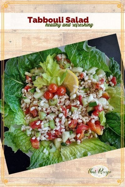 top down view of barley tabbouli salad on a bed of lettuce