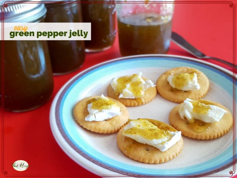 """crackers with brie and green pepper jelly on a plate with jars of jalapeno jelly and text overlay """"easy green pepper jelly"""""""