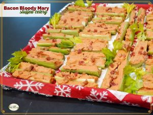 """tray of stuffed celery with text overlay """"Bacon Bloody Mary Stuffed Celery"""""""