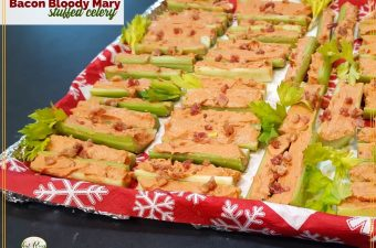 "tray of stuffed celery with text overlay ""Bacon Bloody Mary Stuffed Celery"""
