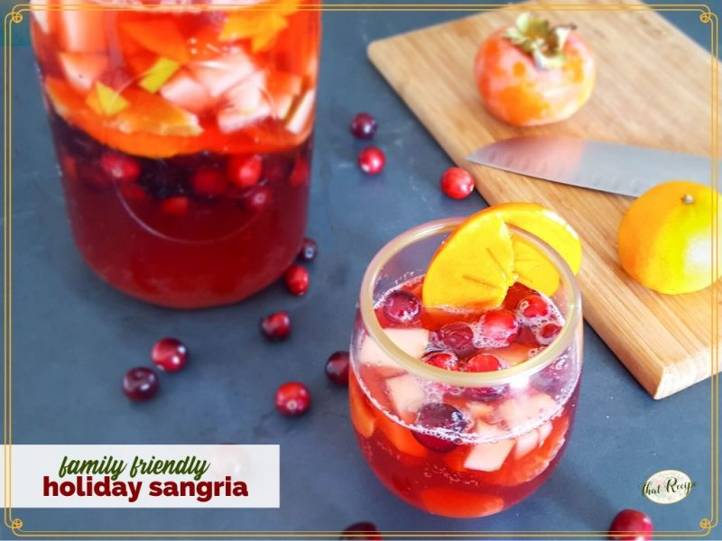 """glass of virgin mocktail with text overlay """"family friendly holiday sangria"""""""