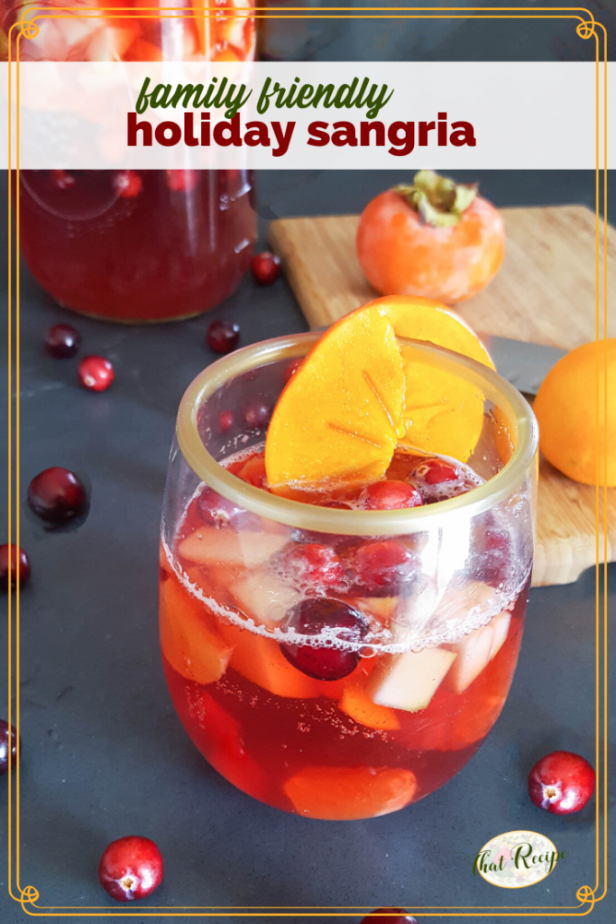 "glass of virgin mocktail with text overlay ""family friendly holiday sangria"""