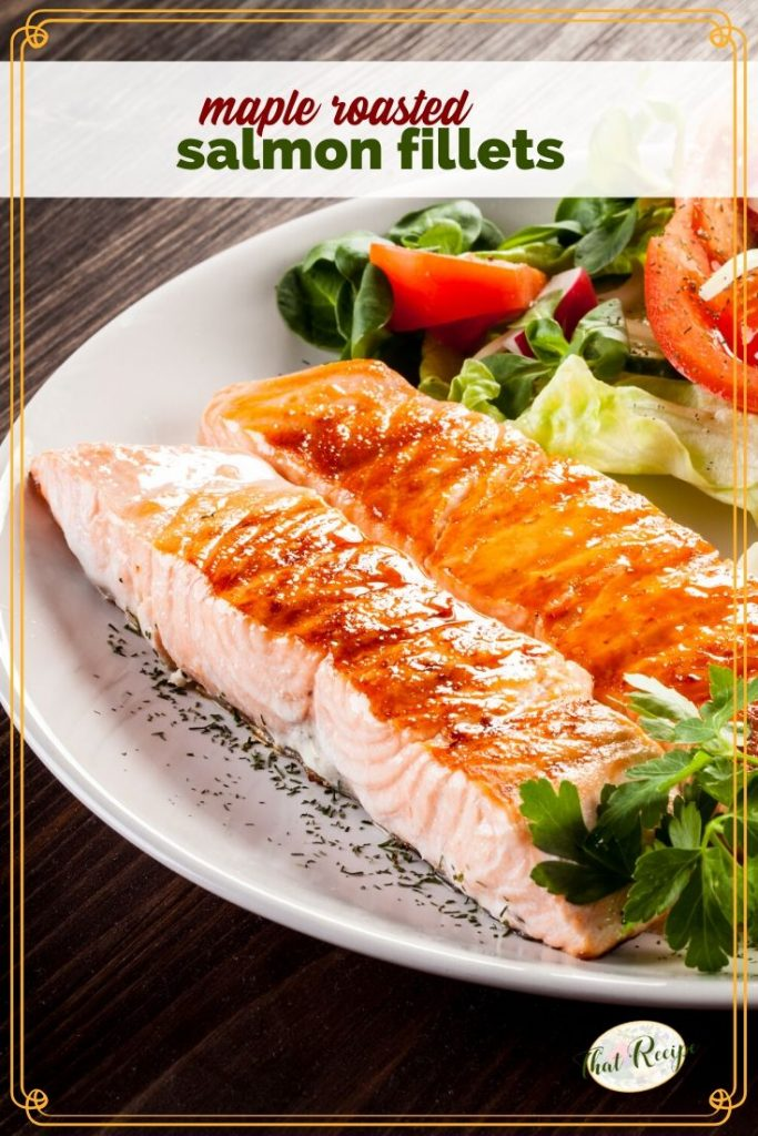 "roasted salmon on a plate with a salad and text overlay ""maple roasted salmon fillets"""