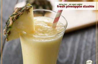 pineapple slushie on a table with sliced pineapple
