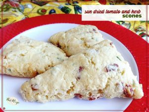 sun dried tomato and herb scones on a plate