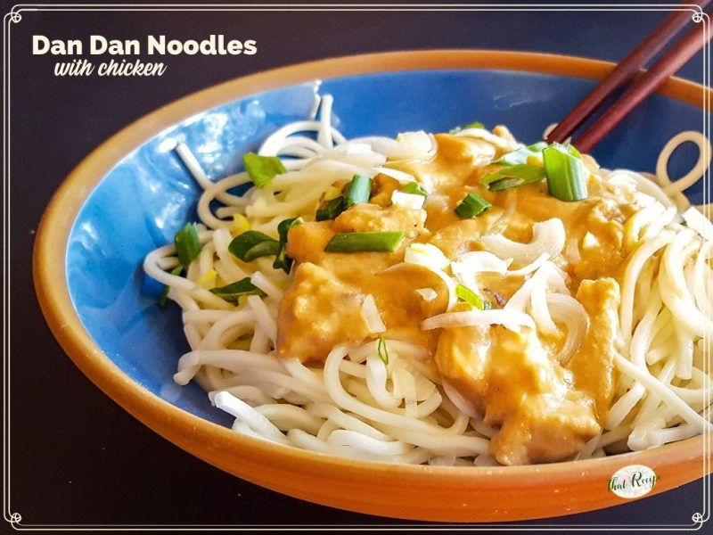 "bowl of chicken and sauce over noodles with text overlay ""Dan Dan Noodles with chicken"""