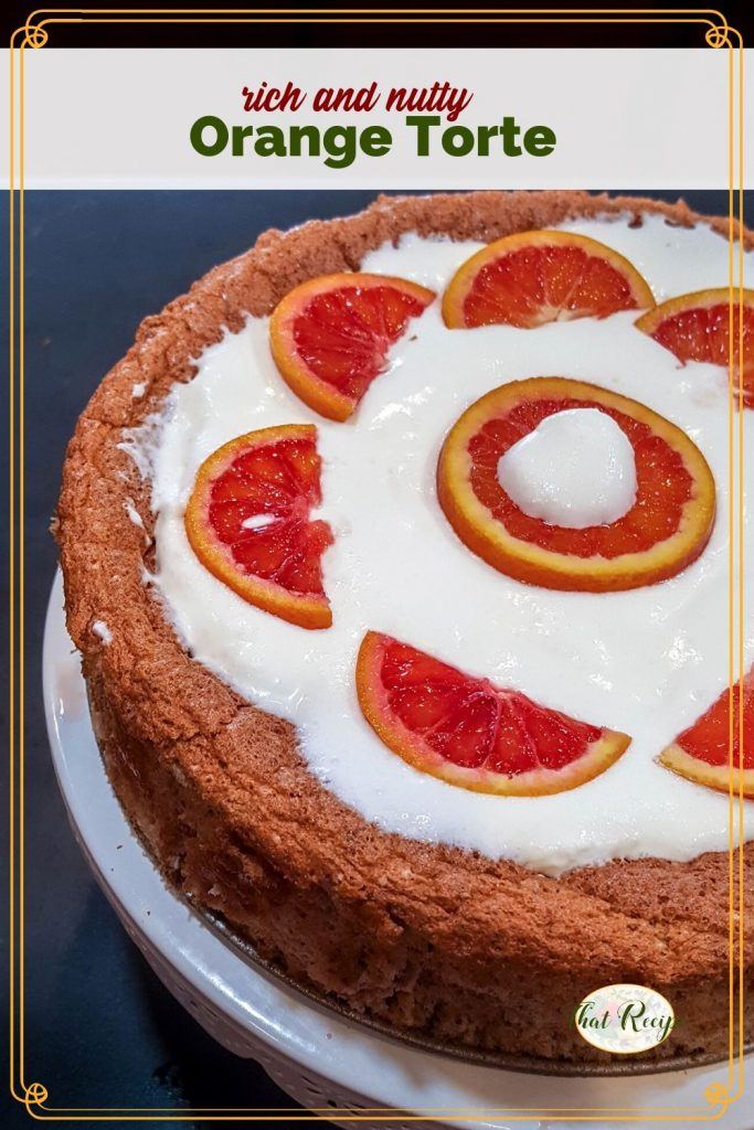 "Nut torte with whipped cream and fresh orange slices with text overlay ""Orange Pecan Torte"""