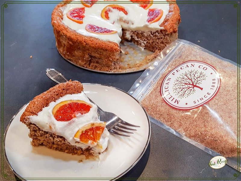 """Nut torte with whipped cream and fresh orange slices with text overlay """"Orange Pecan Torte"""""""