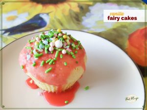 "cupcake with sprinkles on a plate with text overlay ""vanilla fairy cakes"""