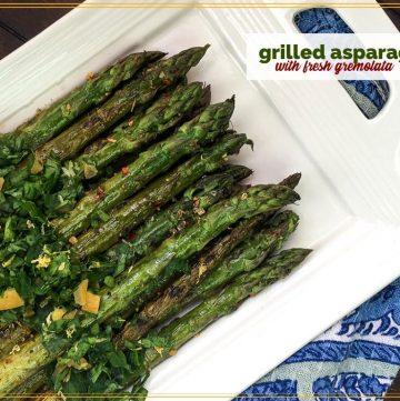 """cooked asparagus on a plate with text overlay """"grilled asparagus with fresh gremolata"""""""
