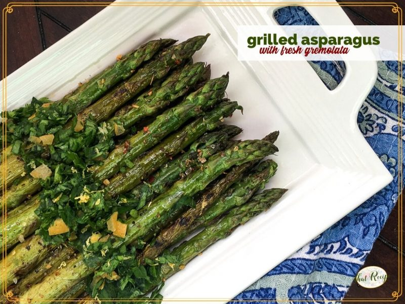 "cooked asparagus on a plate with text overlay ""grilled asparagus with fresh gremolata"""