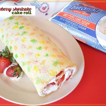 """vanilla swiss cake roll with strawberries and whipped cream with text overlay """"strawberry shortcake cake roll"""""""