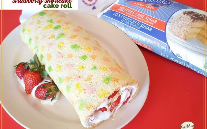 "vanilla swiss cake roll with strawberries and whipped cream with text overlay ""strawberry shortcake cake roll"""