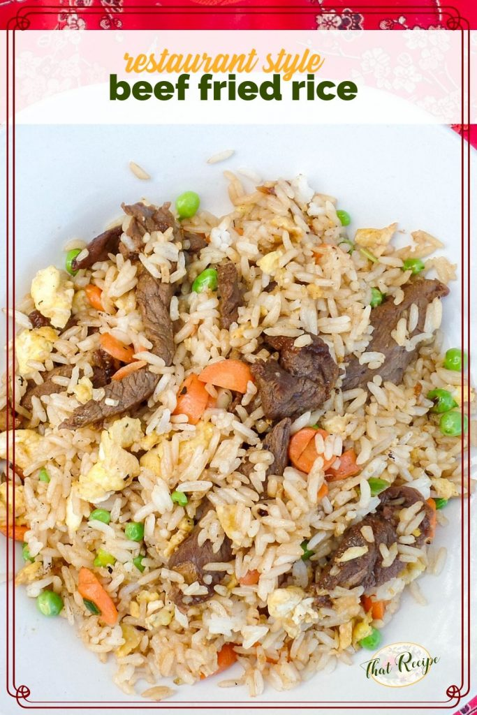 close up of a plate of beef fried rice