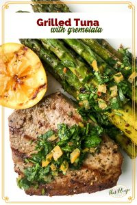 grilled tuna topped with gremolata and grilled lemons and asparagus