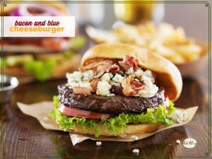 bacon and blue cheese burger on a table with fries